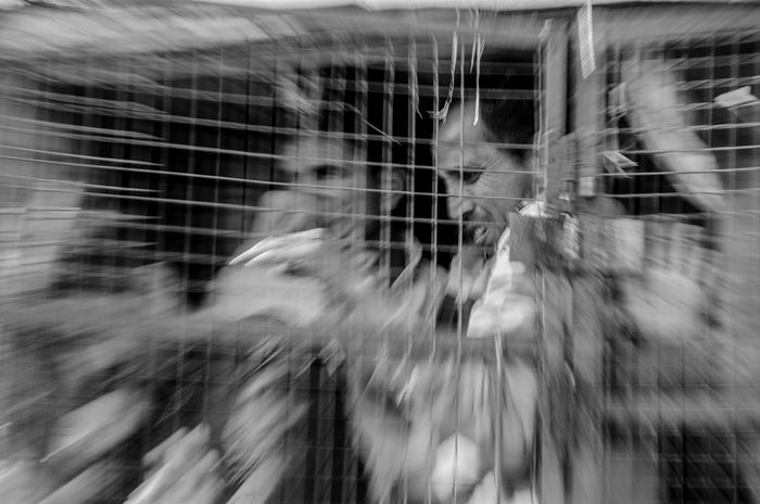October 22, 2015. Srinagar, Jammu and Kashmir, India. Personnel from the Jammu and Kashmit Police detain mourners attempting to defy restrictions on processions through the Srinagar city centre area. Muslims observe mourning rituals and processions, commemorating the slaying of the Prophet Mohammad's grandson, during the Islamic month of Muharram. Every year state authorities impose stringent curfew in the summer capital Srinagar to prevent such processions from passing through while mourners attempt to defy those. Ashura Blurred Motion Close-up Detention India Kashmir Muharram Muslim Police Politics Society