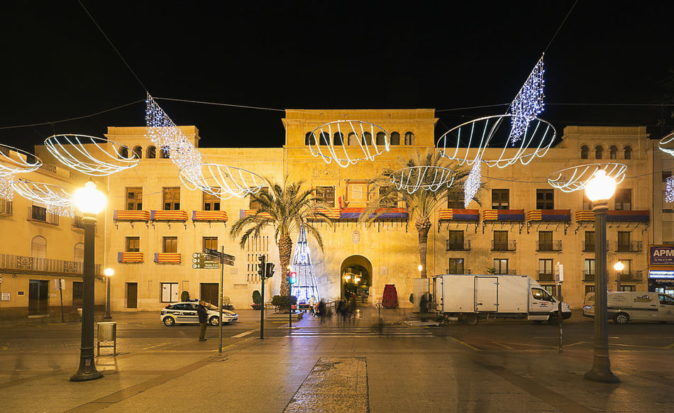 Elche, Spain. December 18, 2017: Town Hall Square of the city of Elche, with Christmas decoration. Alacant Alicante Alicante Province Spain Christmas Elche Elx SPAIN Spanish Travel Architecture Building Exterior Built Structure Chrismas Lights Christmas Decoration Christmas Lights Christmas Ornament City Illuminated Night Outdoors People Travel Destinations