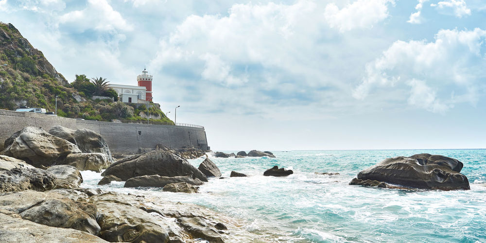 Capo d'Orlando sea Capo D'Orlando Lighthouse Sicily Beach Beauty In Nature Cloud - Sky Day Guidance Horizon Horizon Over Water Italy Land Messina Motion Nature No People Outdoors Rock Rock - Object Rock Formation Scenics - Nature Sea Sky Solid Water
