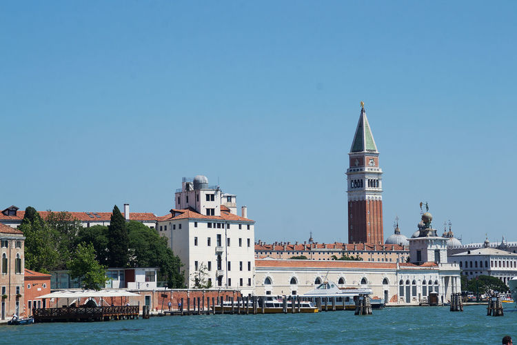 Architecture Bell Tower - Tower Blue Building Exterior Built Structure Campanilla Church Clear Sky Copy Space Day In Front Of No People Old Town Outdoors Sea Tourist Attraction  Town Tranquility Venice Venice Waterfron Water Waterfront