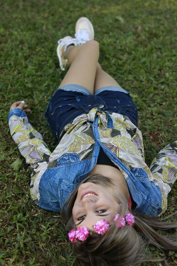 Cheerful Childhood Day Enjoyment Field Freshness Grass Happiness Leisure Activity Lifestyles Lying Down Lying On Back Nature One Person Outdoors People Real People Relaxation Smiling Young Adult