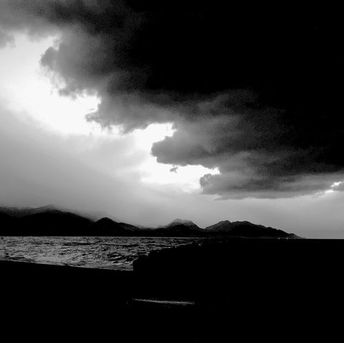 Night storm clouds against first light Water Sea Tree Wave Beach Sky Close-up Silhouette Scenics Idyllic Horizon Over Water