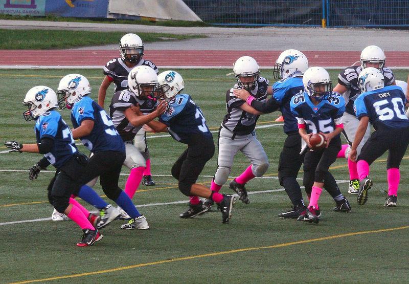 Junior Football at Minoru Park Richmond B.C Canada. Headwear Sport Team Sport Activity Sports Uniform Athlete Competition Sports Helmet Richmond BC, Canada Junior Football Playing Field Minoru Park Teamwork Athlete