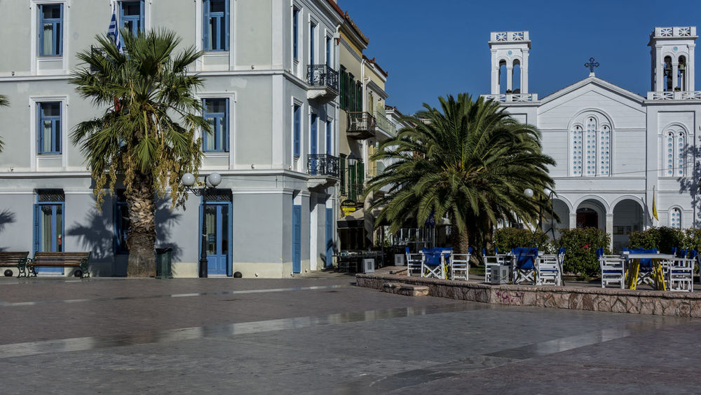 Náfplio Blue Sky Chairs And Tables Church Daylight Greece Hollidays Houses Mediterranean  Mediterranean Sea Nafplion Plaza Trees Without People