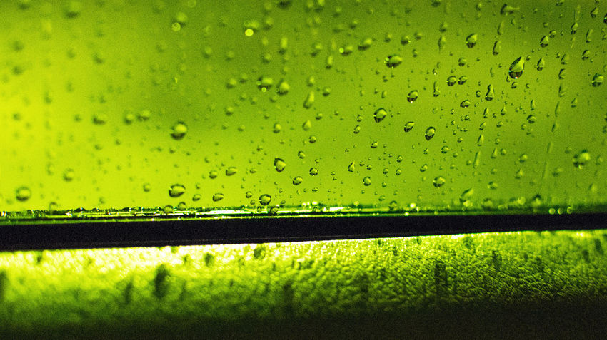 Driving in the rain... Rain Backgrounds Car Close-up Closeup Drop Full Frame Green Color Night No People RainDrop Selective Focus Water Wet Window Windows EyeEmNewHere