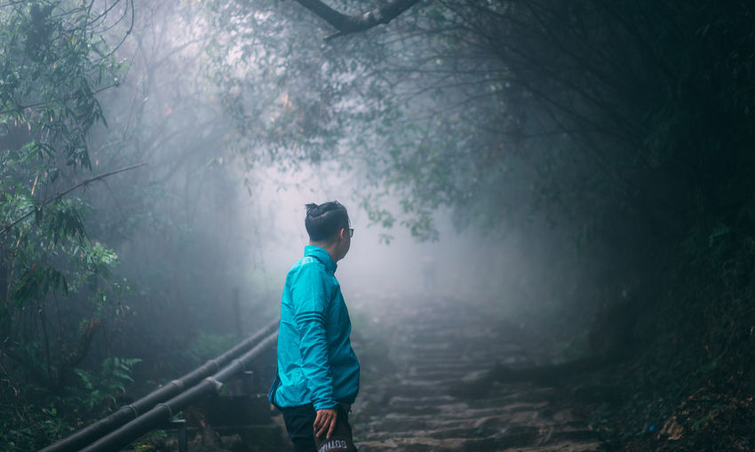 Misty somewhere Casual Clothing Clothing Day Fog Forest Green Color Land Leisure Activity Lifestyles Men Nature One Person Outdoors Plant Real People Standing Tree WoodLand
