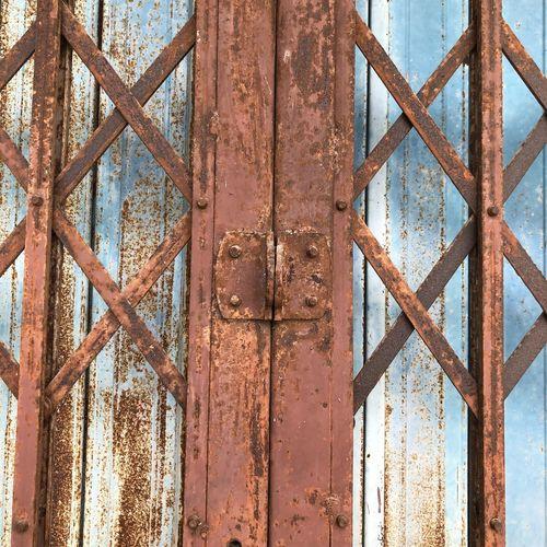Full frame shot of rusty metal gate