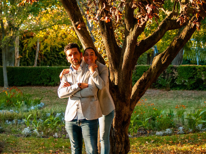 Family Love Environment Autumn Autumn colors Couple Relationship Marriage  Feelings Emotions Young Adult Woman And Man Young Couple In Love Romantic Romanticism Valentine's Day  Valentine Embracing Hug Hugging Lovers Passion Emotion Togetherness Two People Men Tree Plant Smiling Couple - Relationship Adult Three Quarter Length Heterosexual Couple Happiness Males  Positive Emotion Bonding Front View Casual Clothing Women Outdoors Mid Adult Couple Mature Men