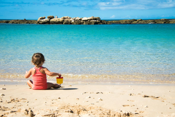 Beach Child Childhood Coastline Day Enjoyment Hawaii Ko Olina Lagoon Leisure Activity Nature One Girl Only One Person Outdoors People Relaxation Sand Sea Sitting Summer Sunlight Swimming Tranquil Scene Vacations Water Miles Away Neighborhood Map Live For The Story EyeEm Ready