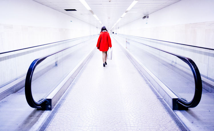Traveling in the subway Away Day Full Length Human Body Part Indoors  Luggage One Person One Woman Only One Young Woman Only Only Women People Rear View Red Subway Traveling Tunnel Vacations Walking