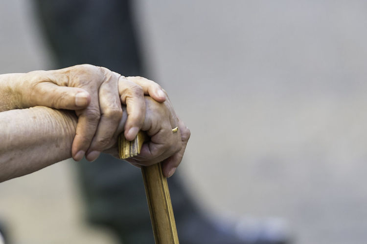 Close-Up Of Senior Person Holding Walking Cane