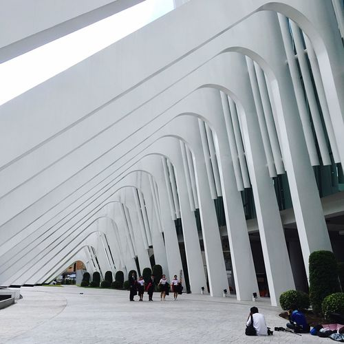 Rangsit University Real People Built Structure Architecture Lifestyles Architectural Column In A Row Men Women Large Group Of People Arch Day City Building Exterior Place Of Worship Outdoors Sky People Bangkok Thailand Architecture