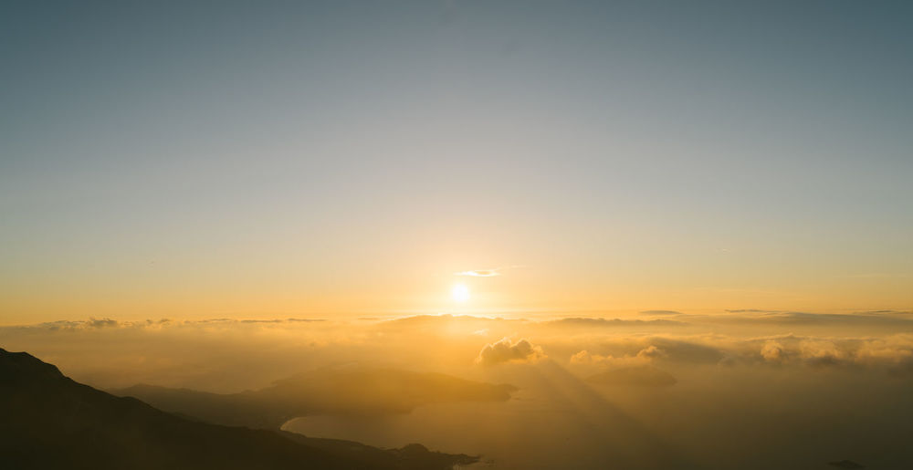 Warm Sunrise Aerial View Astronomy Beauty In Nature Day Ethereal Fog Horizon Landscape Mountain Nature No People Outdoors Refraction Scenics Sky Sun Sunset Tranquil Scene Tranquility