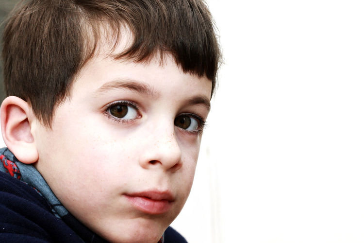 Portrait of a boy with brown eyes. Adolescence  Body Part Boy Boys Child Childhood Close-up Contemplation Headshot Human Body Part Human Face Indoors  Innocence Kid Lifestyles Looking Males  Men Offspring One Person Portrait