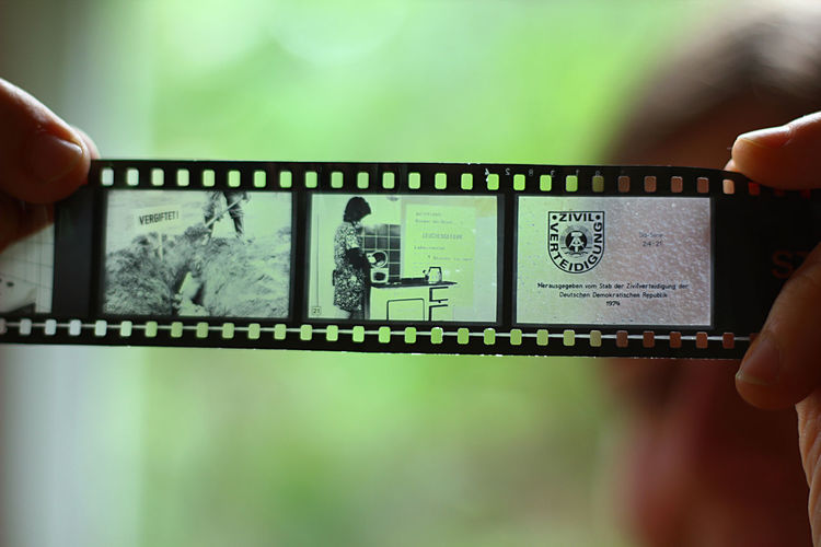 Cinema Cinematic Cinematic Photography Cinematography Communication Connection Contrast Danger Dark Darkness And Light Dia EyeEm Best Shots Film Filmreel Filmstock Focus On Foreground Holding Person Photography Poison Poisonous Propaganda Reel Symbol Transparent