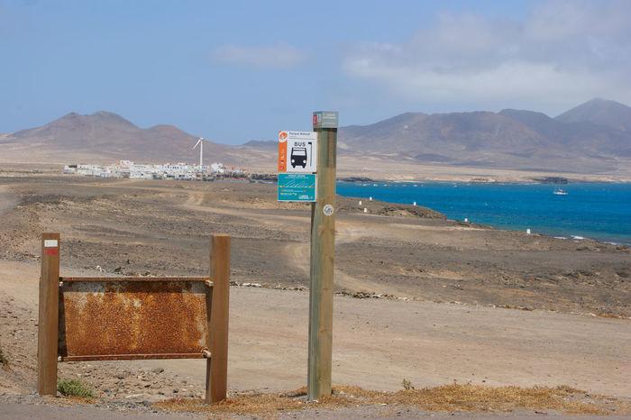 Beach Busstop Canary Islands Faro De Jandía Kanaren Kanarische Inseln Mountain Nature No People Rusty Sign Sand Sea Sky Water