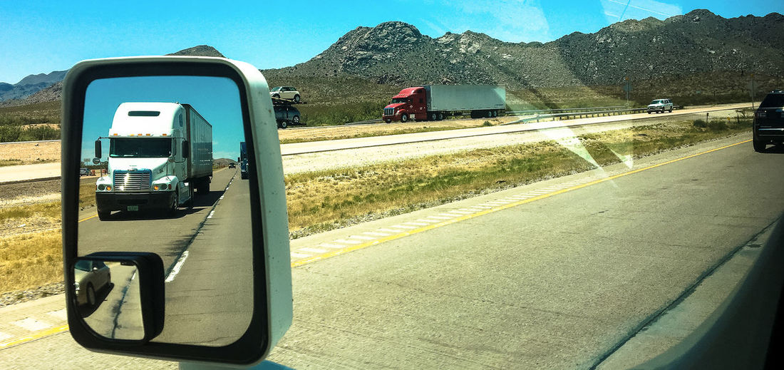 Taken from my RV while driving north from Phoenix to the Grand Canyon. Mirror South Western USA Highway Land Vehicle Mirror View Open Road Outdoors Road Road Trip Transportation Trucks No People The Week On EyeEm EyeEm Best Shots Road Side