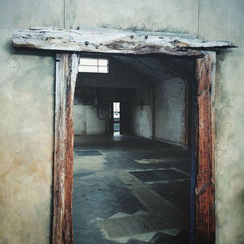 Abandoned Room Seen Through Door