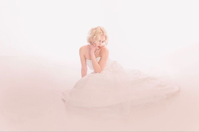 One Person Women Indoors  Adult Studio Shot White Background Blond Hair Hair Sitting Fashion Dress Females Copy Space Newlywed Front View Portrait White Color Wedding Dress Hairstyle Depression - Sadness
