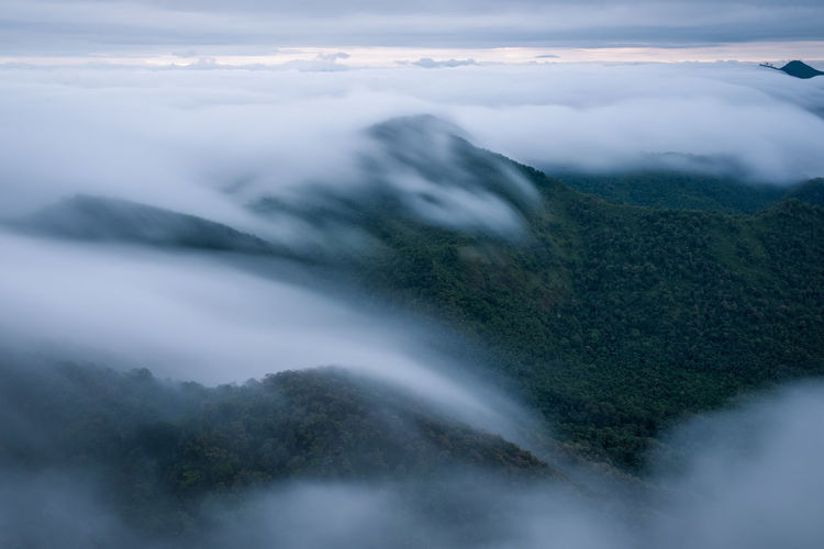 The fog covered the forest in the morning at Khun Yuam, Thailand Abstract Flowing Aerial View Foggy Morning Flowing Water Outdoors Water Land Motion Plant Day Idyllic Environment Non-urban Scene Long Exposure Sky Tranquility Tranquil Scene No People Nature Fog Cloud - Sky Scenics - Nature Beauty In Nature Blurred Motion