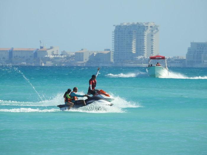 People Riding Jet Ski At Sea