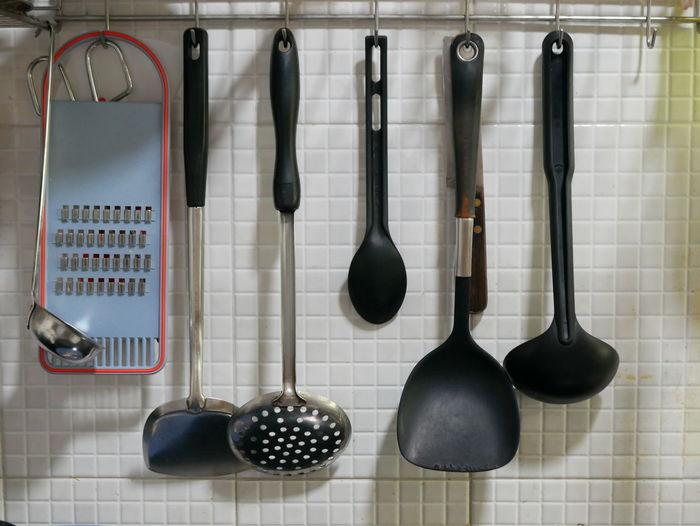 Cookware hanging on floor in kitchen