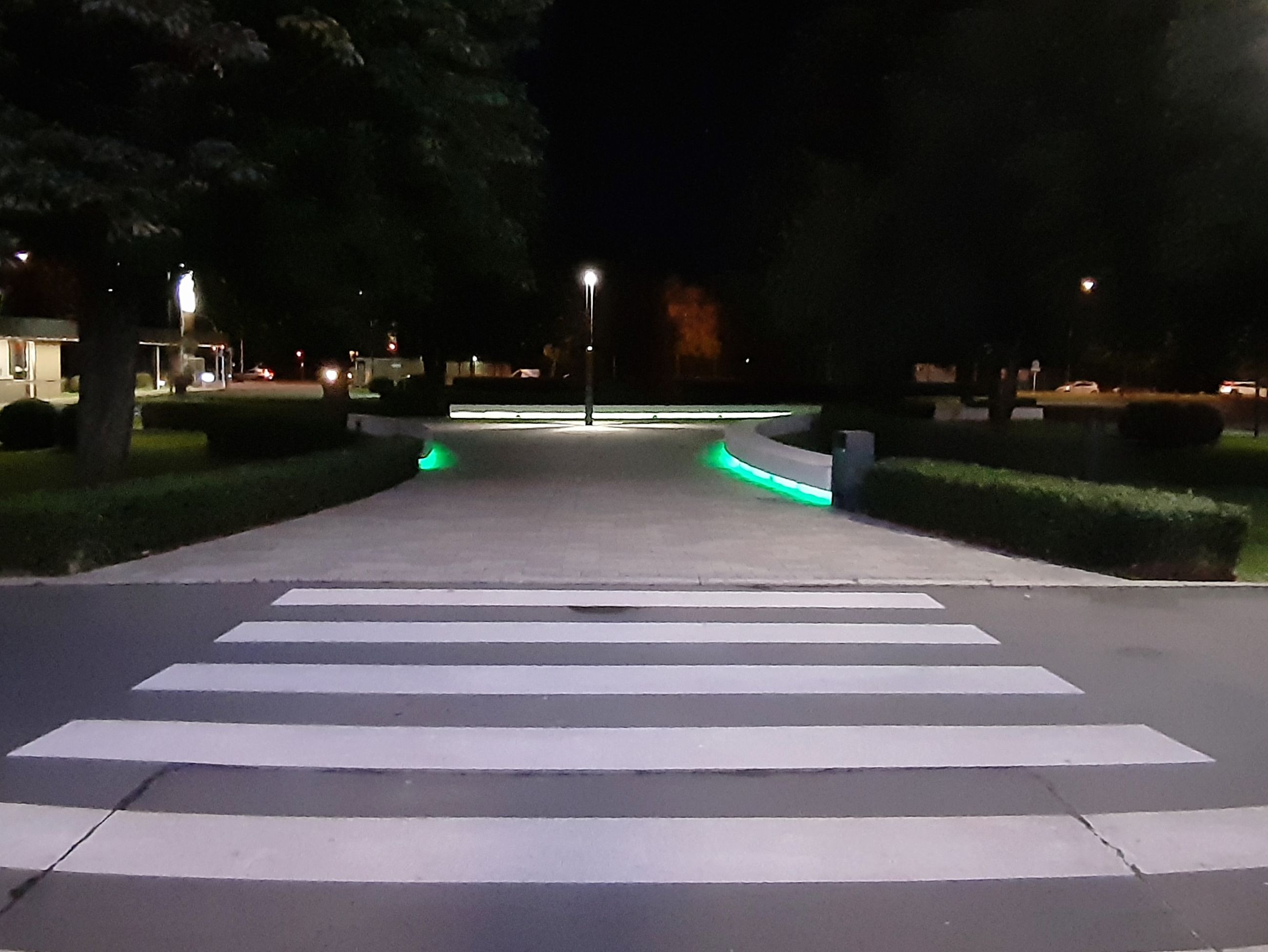 night, city, sign, illuminated, symbol, road marking, crosswalk, marking, road, street, zebra crossing, transportation, architecture, no people, crossing, nature, direction, the way forward, plant, building exterior, outdoors, light