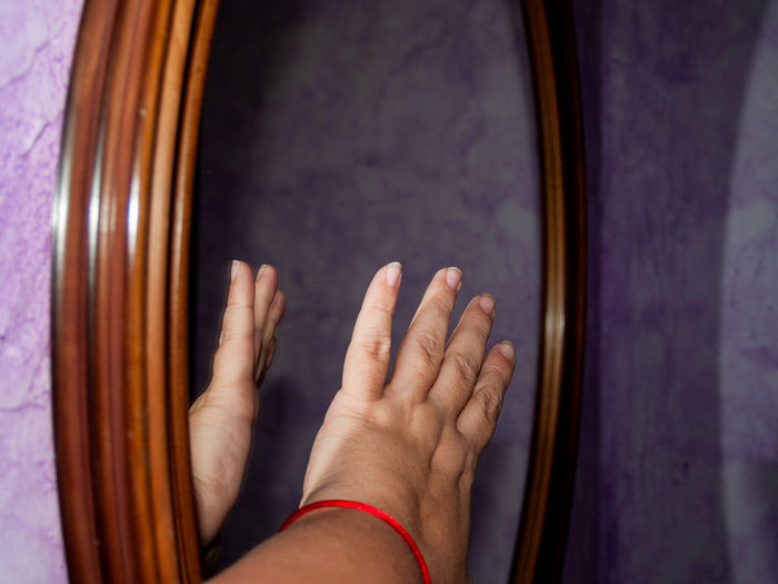 Creativity Mirror Reflection Wood Abstract Adult Arts Culture And Entertainment Body Part Close-up Creative Directly Above Emotion Finger Fingernail Fingers Focus On Foreground Frame Framework Gesture Gesturing Getting Inspired Hand Human Body Part Human Hand Human Limb Indoors  Inspiration Lifestyles Limb Mirror Reflection Musical Instrument People Purple Real People Reflecting Reflections Still Life Studio Shot Touching Wood Frame