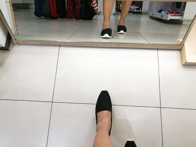 One foot at a time. Human Foot Human Leg Women Adult Lifestyles Low Section Human Body Part Shopping Time Shoes Shoe Shopping Mirror Shoe Shop Feet Feet On The Ground Black Shoes Real People Fashion Standing Only Women Indoors  People One Person Heels For The Ladies Adults Only Break The Mold