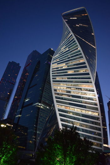Architecture Built Structure Building Exterior City Office Building Exterior Building Sky Skyscraper Nature Modern Travel Destinations Cityscape No People Illuminated Blue Low Angle View Night Urban Skyline City Life Outdoors Financial District  Moscow City Modern Architecture Modern Workplace Culture