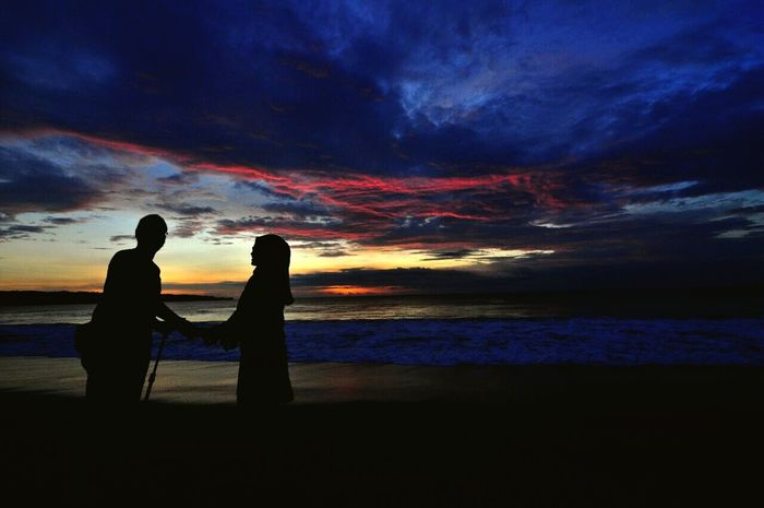 Hold my hand and look at my eyes.. LoveMyHusband Two People Togetherness Sunset Loveindonesia Loveindonesianature