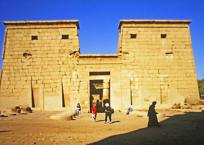 Temple entrance, Egypt Ancient Civilization Architecture Building Exterior Built Structure Clear Sky Day Egyptian Civilization First Obelisk History Leisure Activity Lifestyles Men Nature Outdoors People Real People Sky Standing Sunlight Temple Entrance Tourism Travel Destinations Vacations Women