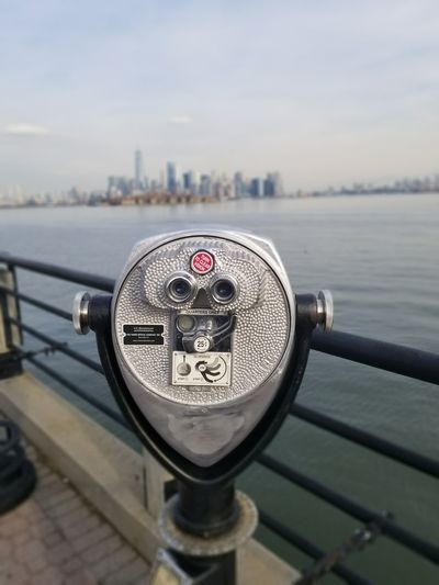 New York City New York Skyline  World Trade Center Building World Trade Center One Manhattan Skyline Downtown Manhattan EyeEm Selects Coin Operated Coin-operated Binoculars Binoculars Metal Water Travel Close-up Cityscape River Observation Point Architecture Railing Focus On Foreground Built Structure City Building Exterior Outdoors No People Travel Destinations The Still Life Photographer - 2018 EyeEm Awards