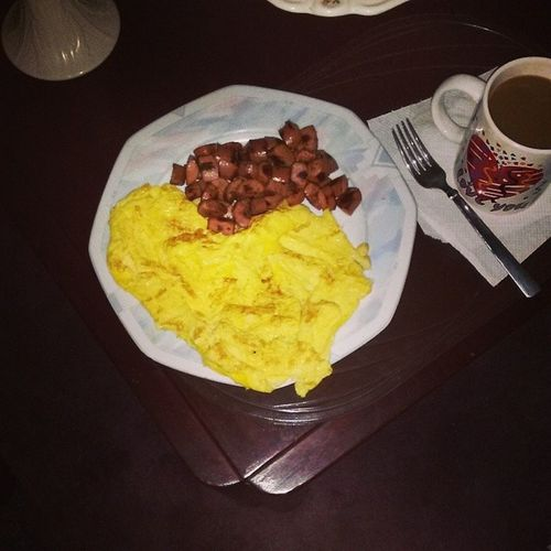 Suttin light Eggomelet Friedhotdogs cut in pieces and Coffee on the side Allme breakfast yadig yeabuddyyeaboy