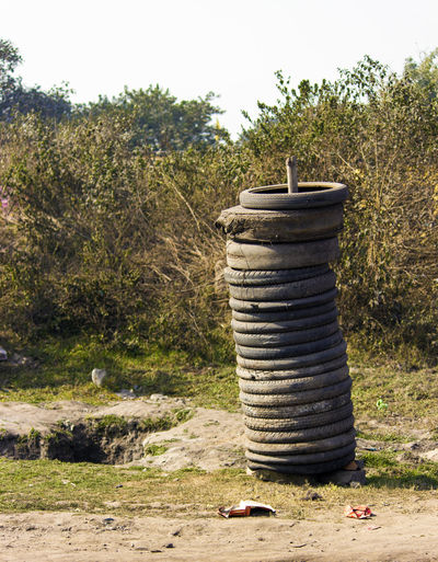 EyeEm Gallery EyeEmNewHere Old Tyres Repairing Rural Clear Sky Day Field Grass Growth Layer Layers Nature No People Outdoors Rural Scene Sky Stack Streat Streatphotograpy Tire Tree Tyre Tyre Change Tyres