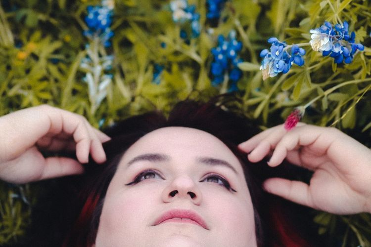 Laying down on a sunday afternoon in the texas bluebonnets