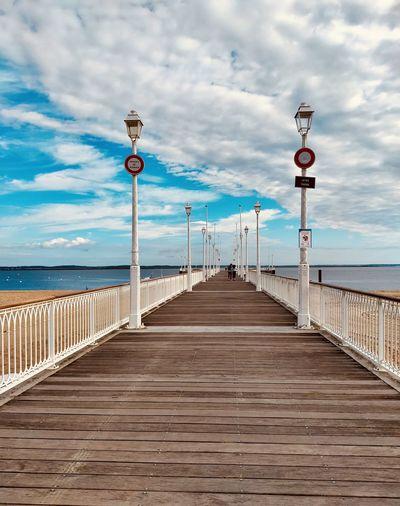 Pier amidst sea against sky