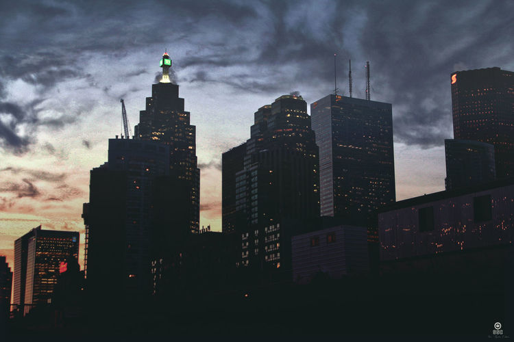 Shot By Sean Diamond Architecture Building Exterior Built Structure City Cityscape Cloud - Sky Downtown District Dusk Illuminated Low Angle View Modern Night No People Outdoors Sky Skyscraper Storm Cloud Sunset Travel Destinations Urban Skyline