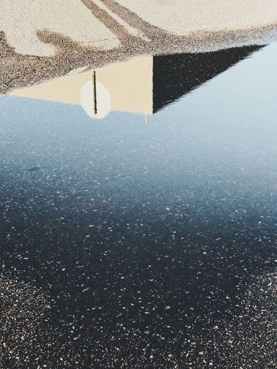 High angle view of puddle on beach against sky