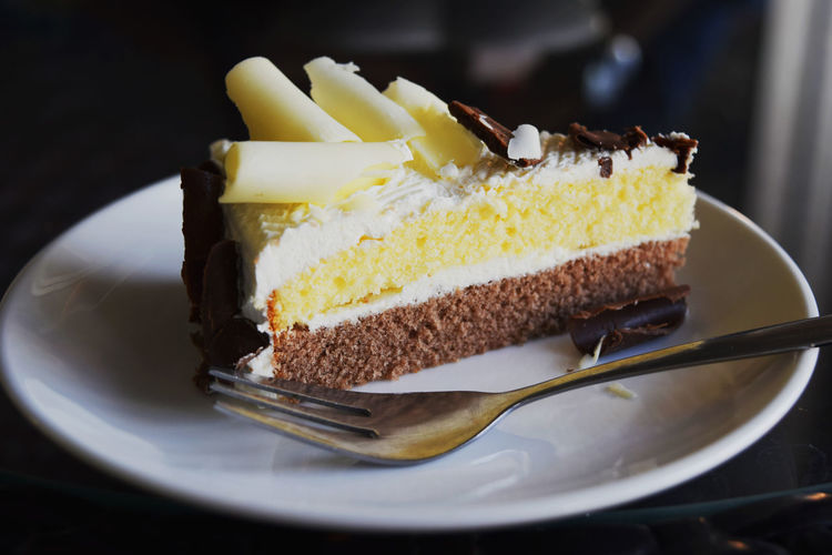 Bakery Cake Cheesecake Close-up Comfort Food Cream Day Dessert Dessert Topping Food Food And Drink Freshness Gourmet Indulgence Melting No People Plate Ready-to-eat SLICE Slice Of Cake Sweet Food Sweet Pie Yellow