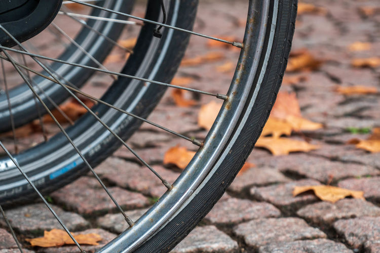 Close-up of bicycle wheels on street
