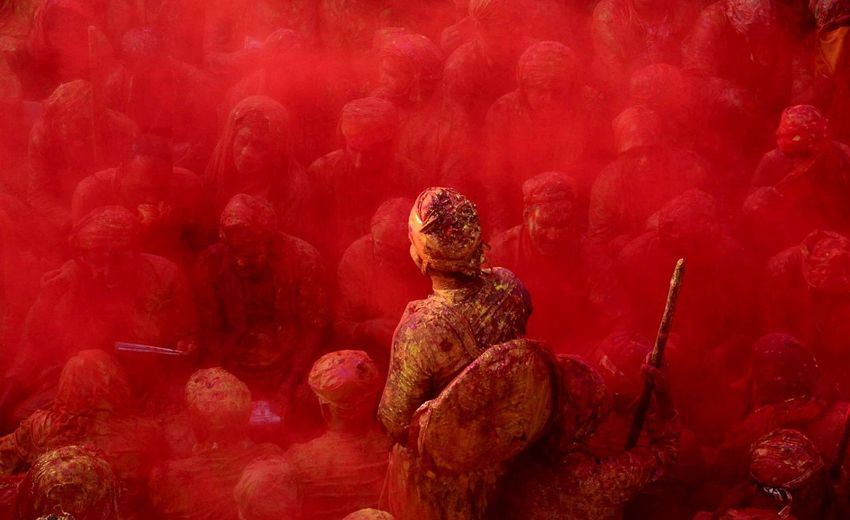 Indian reveles play with coloured powders to celebrate holi festival in Nand Gaon , some 53 kms from Mathura . Human Representation Red Statue Sculpture Outdoors Day Holi Powder Paint Close-up EyeEmNewHere