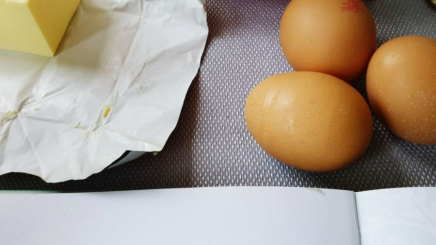 High Angle View Of Eggs And Butter On Table