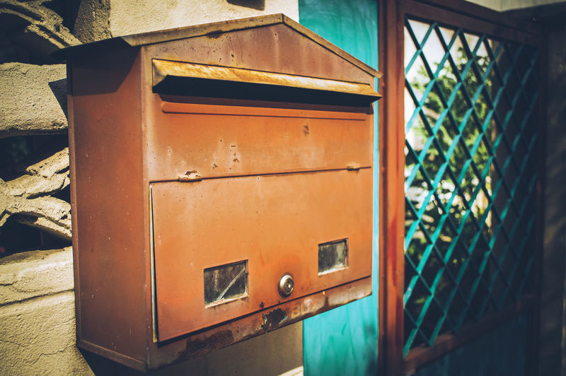 Close-up of mailbox on building wall