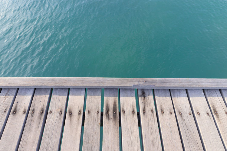 Thailand Architecture Background Beauty In Nature Beauty In Nature Blue Clean Clear Water Day High Angle View Jetty Lake Nature No People Outdoors Pattern Pier Plank Sunlight Tranquility Turquoise Colored Water Wood Wood - Material Wood Paneling