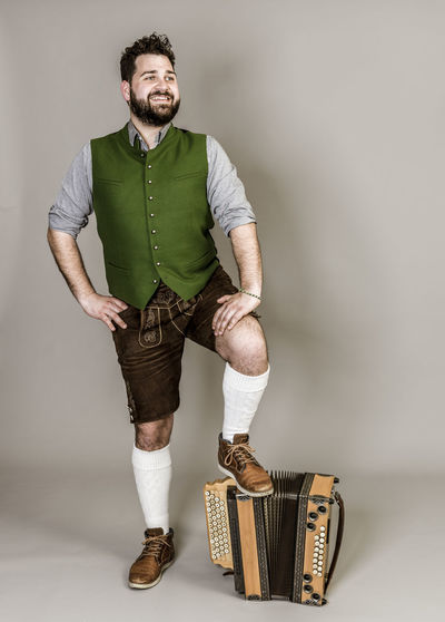 Musician Costume Leather Trousers Tradition Traditional Austria Green Pose Accordion Man Young Shorts Friendly Proud Happy Play Music Fun Joy Single One Background Copy Space Studio Entertainment Mountains Shirt STAND Hobby Leisure Cool Full Length Indoors  One Person Portrait Young Adult Front View Looking At Camera Young Men Casual Clothing Standing Beard Studio Shot Real People Smiling Facial Hair Wall - Building Feature Mid Adult Adult