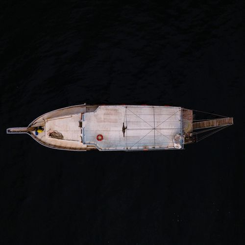 Low angle view of boat against black background