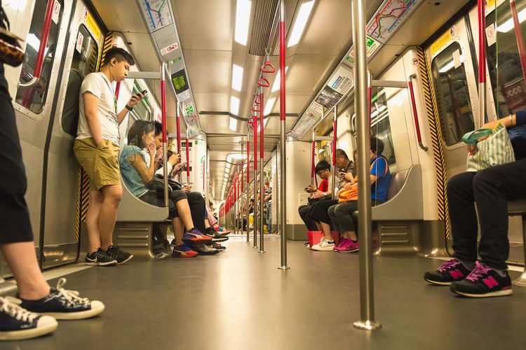 Group Of People Women Vehicle Interior Adult Men Public Transportation Travel Mode Of Transportation Transportation Lifestyles Real People Indoors  Rail Transportation Subway Train Vehicle Seat People Medium Group Of People Leisure Activity Group Journey