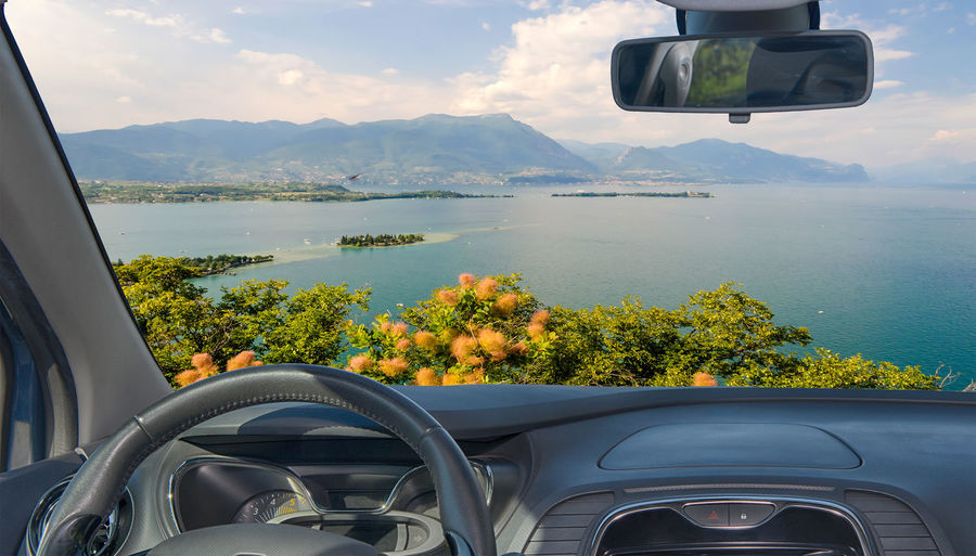 Scenic view of mountains seen through car windshield