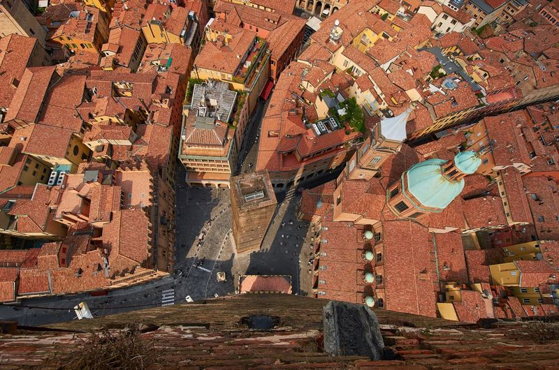 Wide angle view from the Asinelli Tower in Bologna Bologna Italy Asinelli Tower  Aerial View Cityscape Urban Looking Down Rooftops Tower Historic Historical Building Architecture High Angle View Travel Destinations No People Built Structure Church Dome Cupola